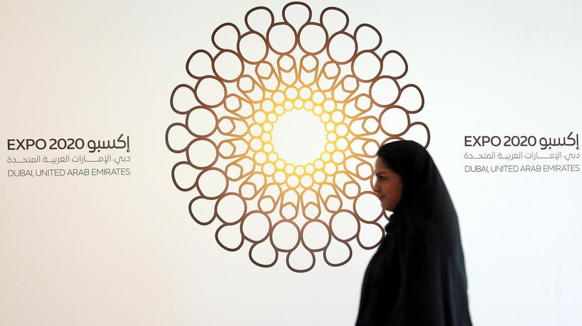 A woman walks past the logo of the Expo 2020 in Dubai, United Arab Emirates, April 3, 2017. (Reuters)