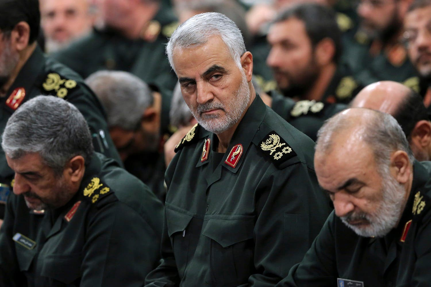 In this Sept. 18, 2016 photo Revolutionary Guard Gen. Qassem Soleimani, center, attends a meeting with Supreme Leader Ayatollah Ali Khamenei and Revolutionary Guard commanders in Tehran, Iran. (AP)