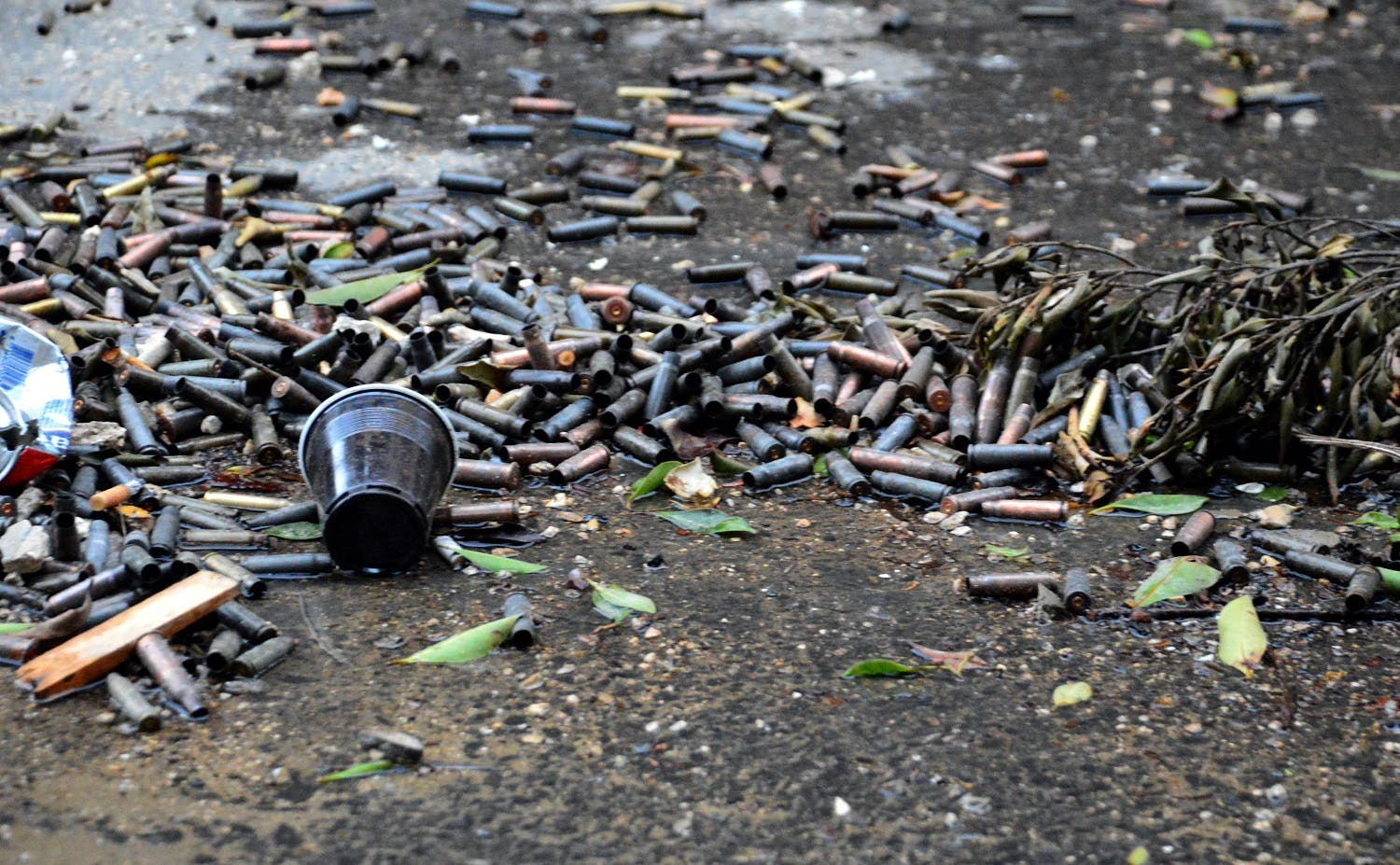 A picture taken on April 12, 2017 shows spent bullet casings lying on the ground at Ain al-Hilweh camp. (AFP)