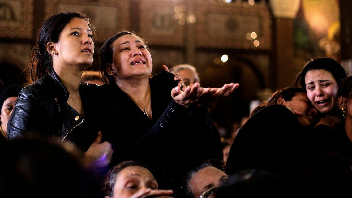 Women cry during the funeral for those killed in a Palm Sunday church attack in Alexandria Egypt, at the Mar Amina church, Monday, April 10, 2017. (AP)