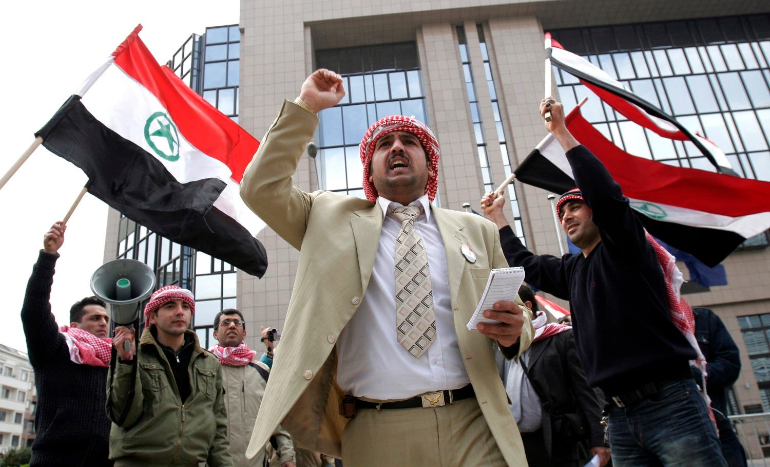 An unidentified man chants as others wave the flag of the Al Ahwaz Liberation Organization during a protest in front of the European Council building in Brussels, on April 18, 2008. (AP)