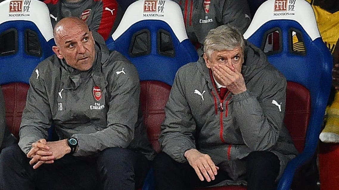 Arsenal's French manager Arsene Wenger (R) and assistant Steve Bould gesture in their seats during the English Premier League football match between Crystal Palace and Arsenal at Selhurst Park in south London on April 10, 2017. Crystal Palace won the game 3-0. AFP