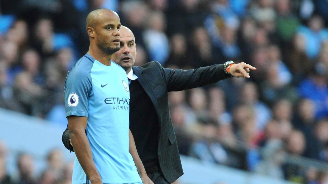 Manchester City manager Josep Guardiola, right, brings Manchester City's Vincent Kompany as a substitute during the English Premier League soccer match between Manchester City and Everton at the Etihad Stadium in Manchester, England, Saturday, Oct. 15, 2016. (AP)