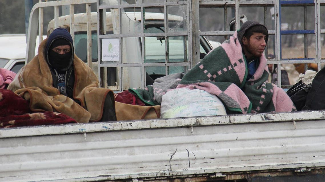 Syrians being evacuated from Aleppo are seen in the back of a pick up truck as it drives through a rebel-held territory near Rashidin on December 22, 2016. (File photo: AFP)