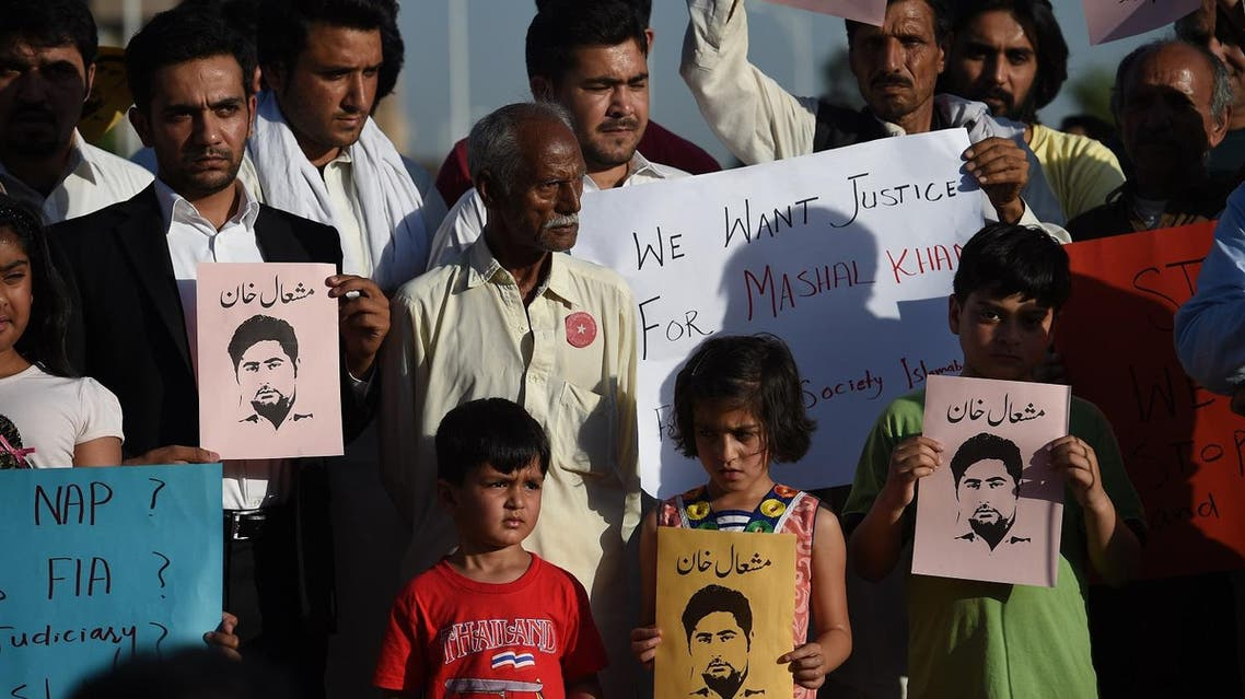 Pakistani civil society members, university students and children hold placards as they take part in a protest against the killing of Mashal Khan, a journalism student, in Islamabad on April 15, 2017. (AFP)