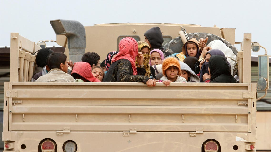 Displaced Iraqi people who fled Islamic State militants arrive in Kirkuk to be transported to camps for displaced people, Iraq, March 23, 2017