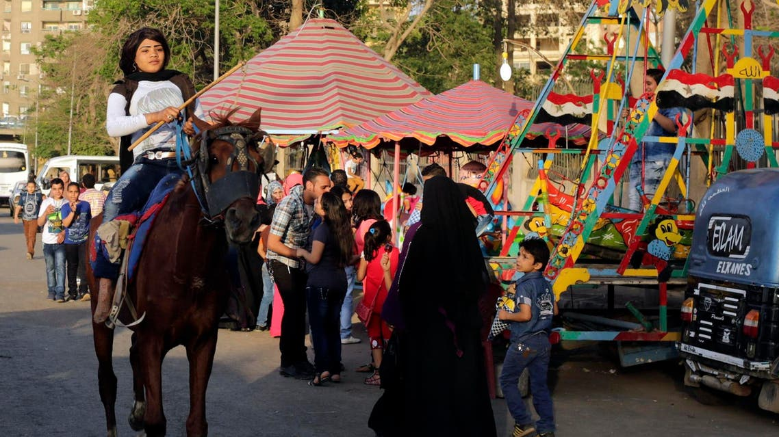 A girl rides a horse near the Nile river as people celebrate the spring holiday of Sham el-Nessim in Cairo April 21, 2014. (File photo: Reuters)