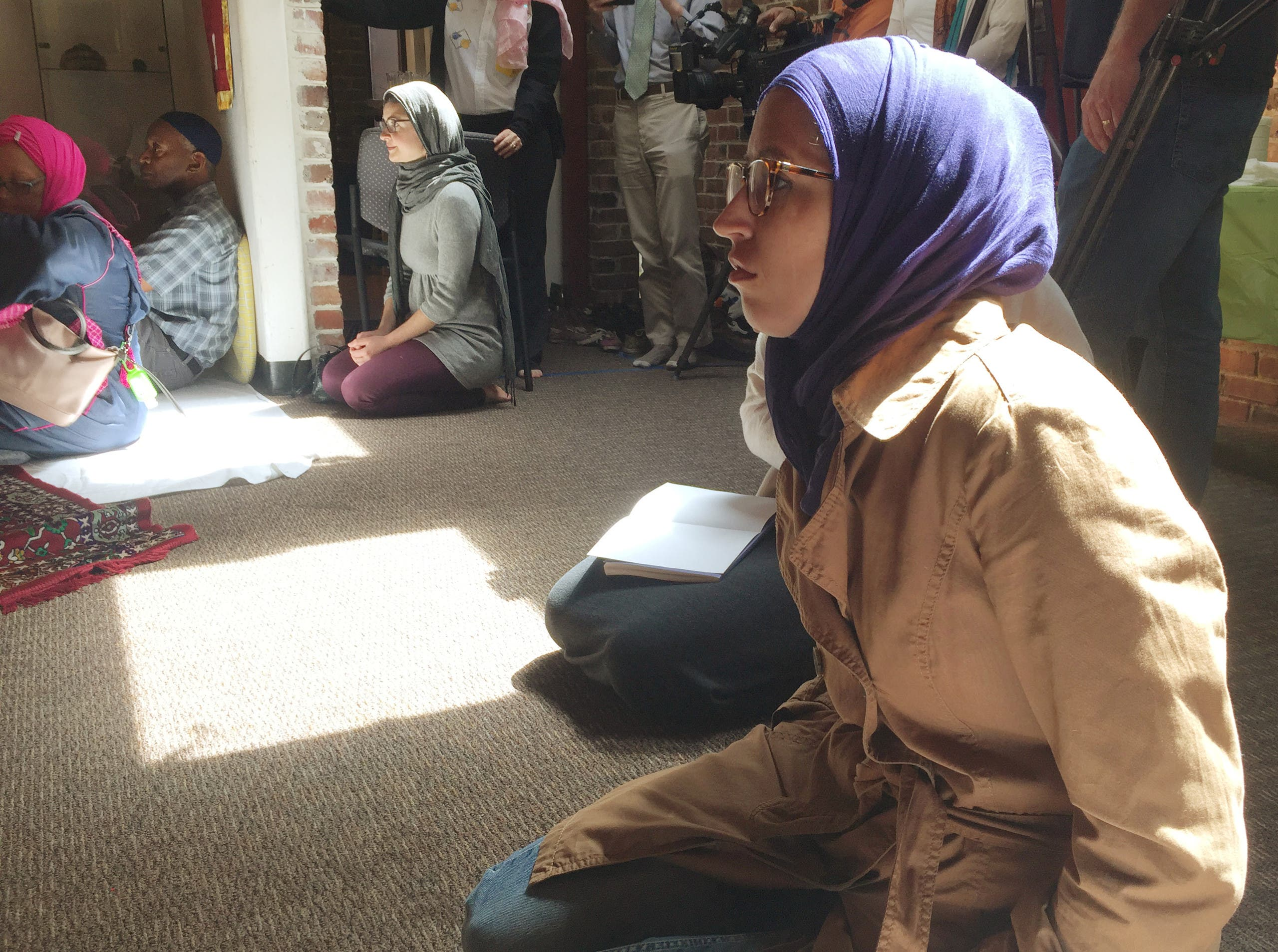 Worshipers sit and listen to prayers and a sermon at the Qal'bu Maryam Women's Mosque which held its first service on Good Friday, at the Starr King School for the Ministry in Berkeley, California, U.S., April 14, 2017. REUTERS/Lisa Fernandez