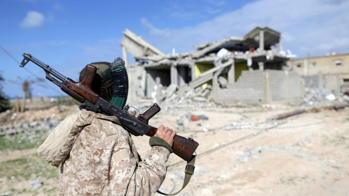 A member of East Libyan forces holds his weapon as he stands in front of a destroyed house in Ganfouda district in Benghazi, Libya, January 28, 2017. (File photo: Reuters)