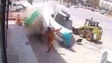 WATCH: Workman in lucky escape with runaway van on Saudi road