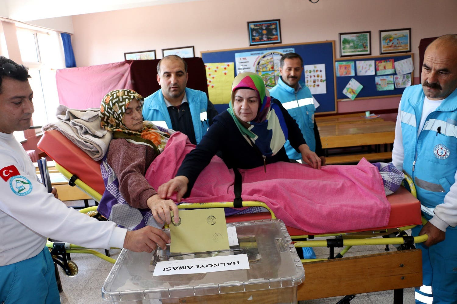 Fatma Canpolat, a paralysed woman who was wheeled into a polling station, casts her ballot in Erzincan, Turkey, Sunday, April 16, 2017 (Photo: Depo Photo via AP)