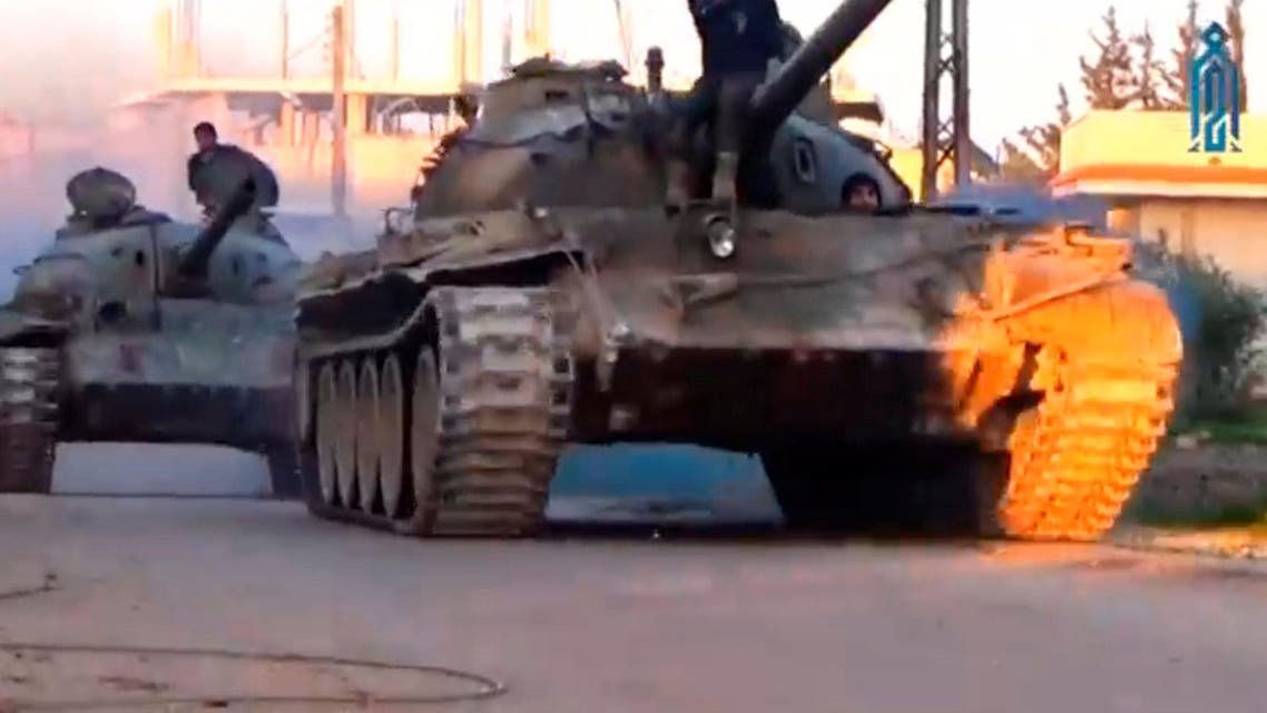 A still image taken from a video uploaded on social media on March 22, 2017, purports to show Tahrir al-Sham rebel fighters on tanks, said to be in Soran district, near Hama, Syria. (Social Media Website via Reuters)