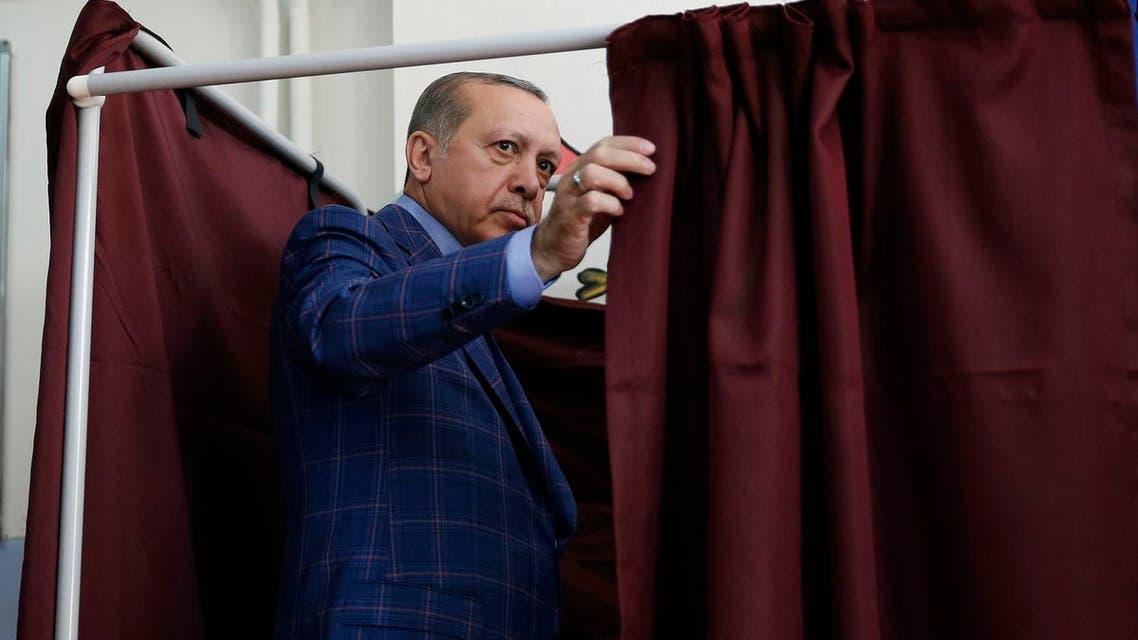 Turkey's President Recep Tayyip Erdogan enters a voting booth inside a polling station in Istanbul, Turkey, on Sunday, April 16, 2017 (Photo: AP/Lefteris Pitarakis)