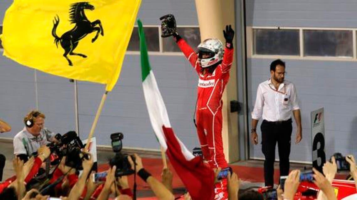 Ferrari driver Sebastian Vettel of Germany celebrates after winning the Bahrain Formula One Grand Prix, at the Formula One Bahrain International Circuit in Sakhir, Bahrain, Sunday, April 16, 2017. (AP PhotoHassan Ammar)