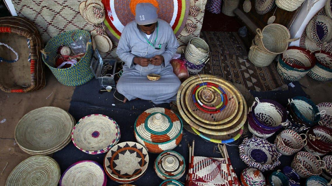 A man makes handmade ornamental products during Janadriyah Culture Festival on the outskirts of Riyadh, Saudi Arabia February 8, 2017. (Reuters)