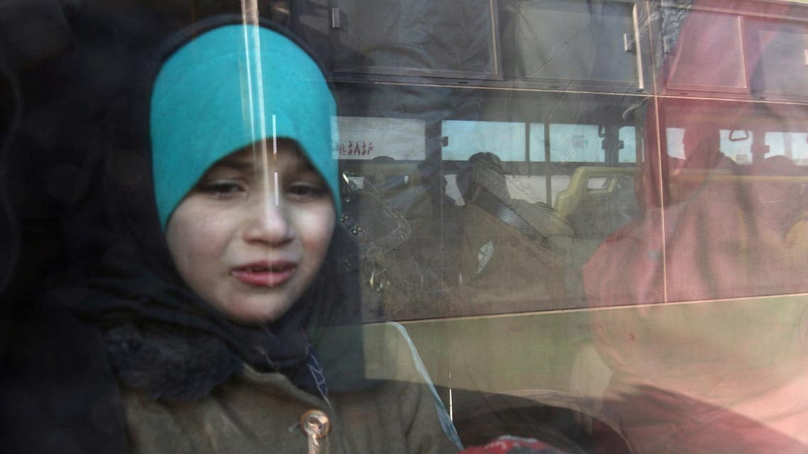 File photo: A girl rides a bus to be evacuated from a rebel-held sector of eastern Aleppo, Syria December 18, 2016. (Reuters)