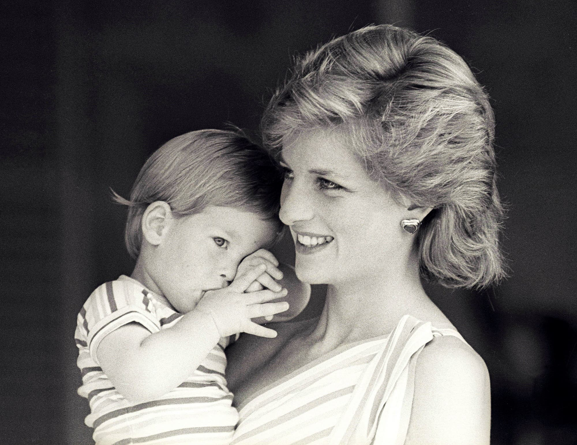 FILE PHOTO - Britain's Princess Diana holds Prince Harry during a morning picture session at Marivent Palace, where the Prince and Princess of Wales are holidaying as guests of King Juan Carlos and Queen Sofia, in Mallorca, Spain August 9, 1988. REUTERS