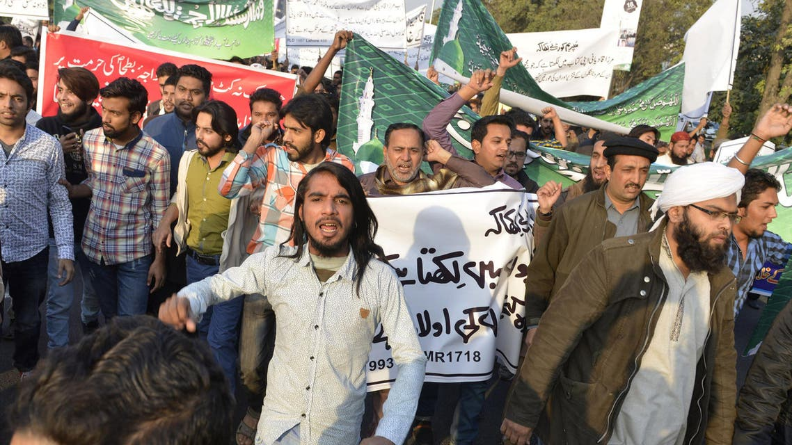 Pakistanis protest against the arrest of a shopkeeper charged with blasphemy after he banned members of the Ahmadi minority from entering his shop. ap
