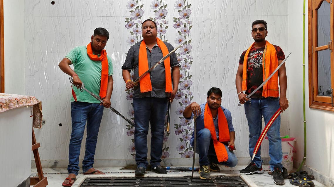 Hindu Yuva Vahini members pose inside the vigilante group's office in the city of Unnao, India, April 5, 2017. Picture taken April 5, 2017. REUTERS