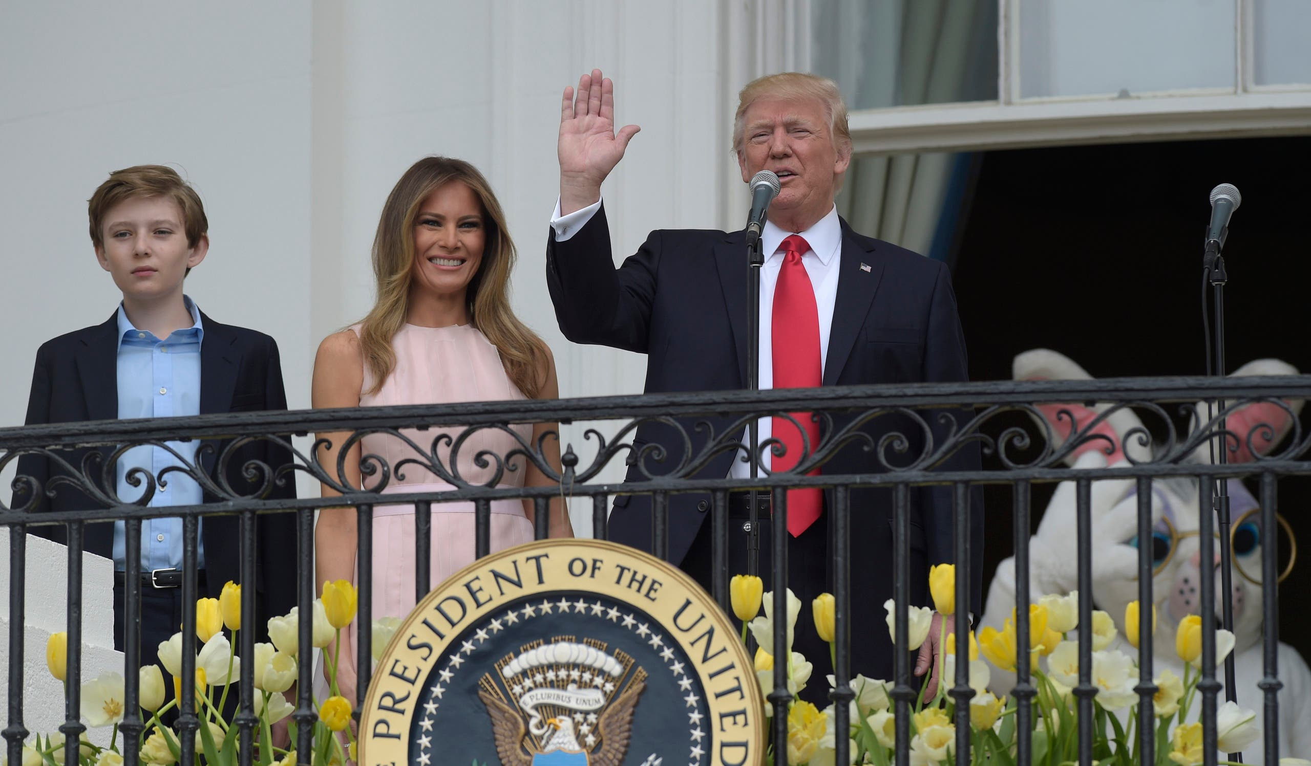 President Donald Trump, with first lady Melania Trump and their son Barron Trump, address the crowd at the annual White House Easter Egg Roll on the South Lawn of the White House in Washington, Monday, April 17, 2017. (AP)