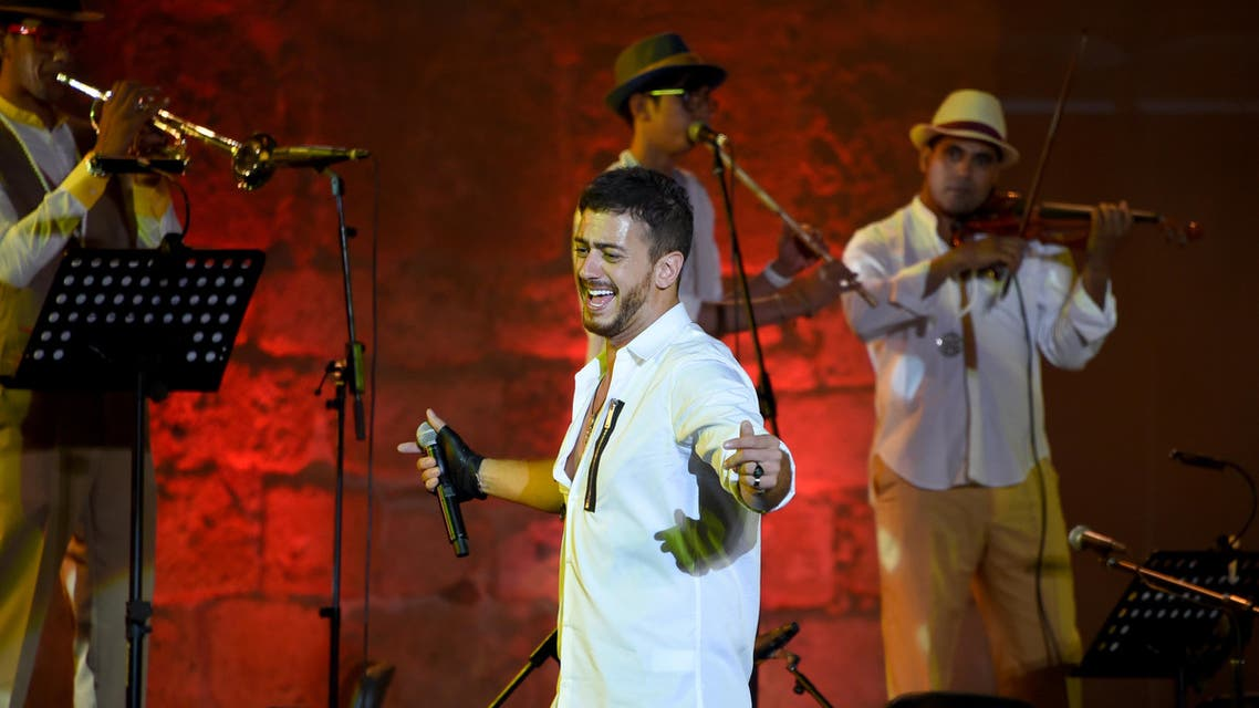 Morocco singer Saad Lamjarred performs with Ukrainian Orchestra Symphonic at the opening of the Carthage Festival on July 30, 2016 at the romain theatre of carthage near Tunis. FETHI BELAID / AFP