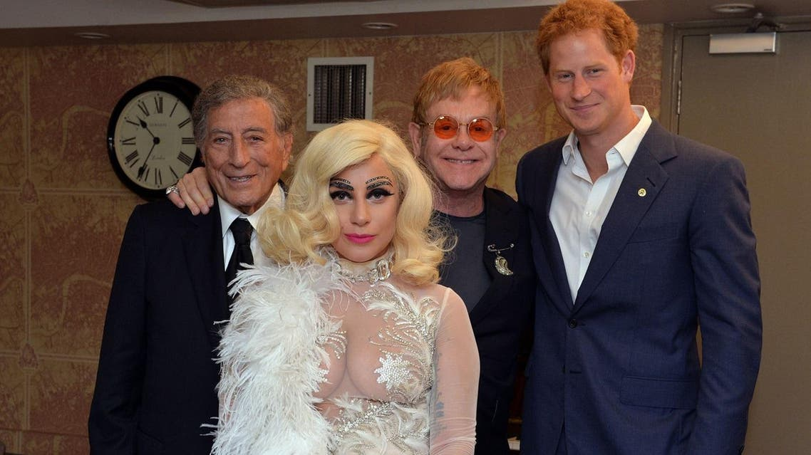 From right, Britain's Prince Harry, Elton John, Lady Gaga and Tony Bennett pose backstage for photographs after Bennett and Lady Gaga's performance as part of the Cheek to Cheek Tour at the Royal Albert Hall in London, Monday, June 8, 2015. (AP)