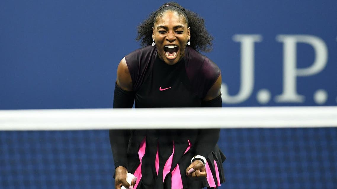 """(FILES) This file photo taken on September 8, 2016 shows Serena Williams of the US reacting after winning a point against Karolina Pliskova of Czech Republic during their 2016 US Open Women's Singles semifinal match at the USTA Billie Jean King National Tennis Center in New York. Tennis great Serena Williams hinted April 19, 2017 that she's expecting her first child, posting a photo of herself on Snapchat captioned """"20 weeks"""". The photo, captured by US media, shows Williams in a yellow swimsuit with what appears to be a baby bump.Williams, 35, hasn't played since beating her sister Venus in the final of the Australian Open in January to clinch a record 23rd Grand Slam singles title. AFP"""