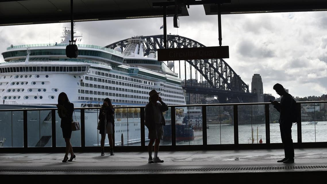 People wait for a train at Circular Quay in Sydney on April 19, 2017. (AFP)