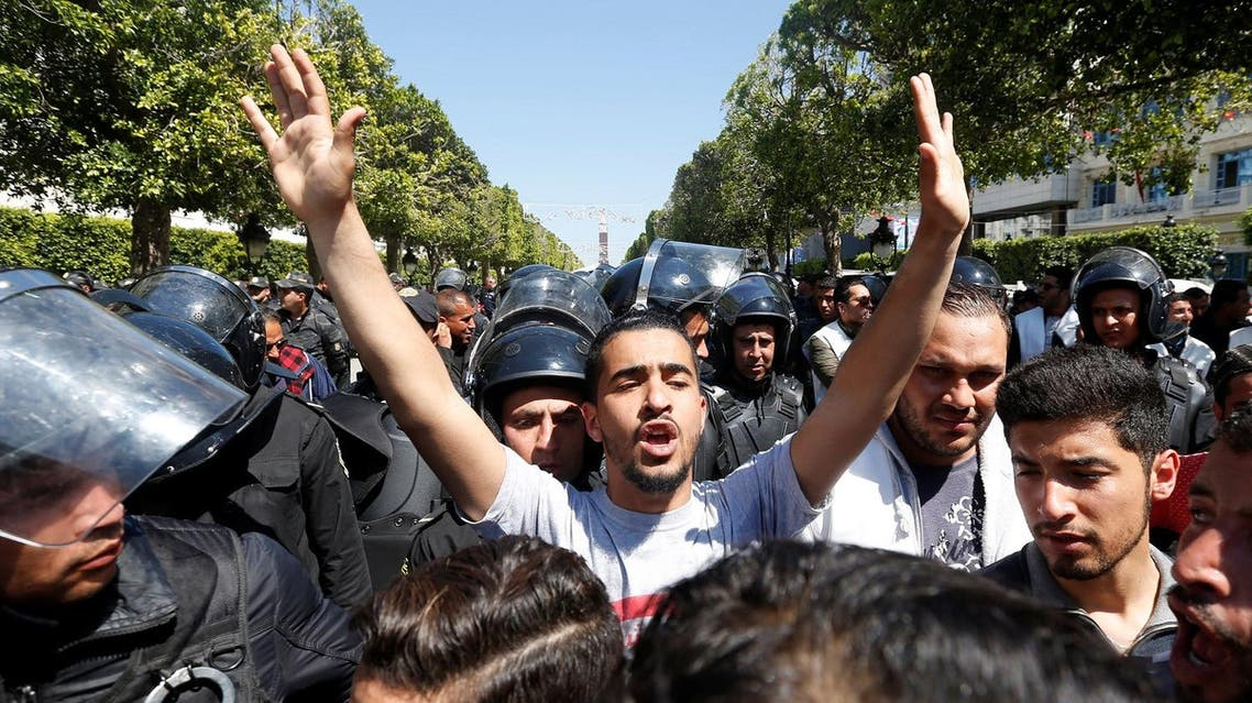 Law students clash with riot police officers, during a demonstration against the government in Tunis. (File photo: Reuters)