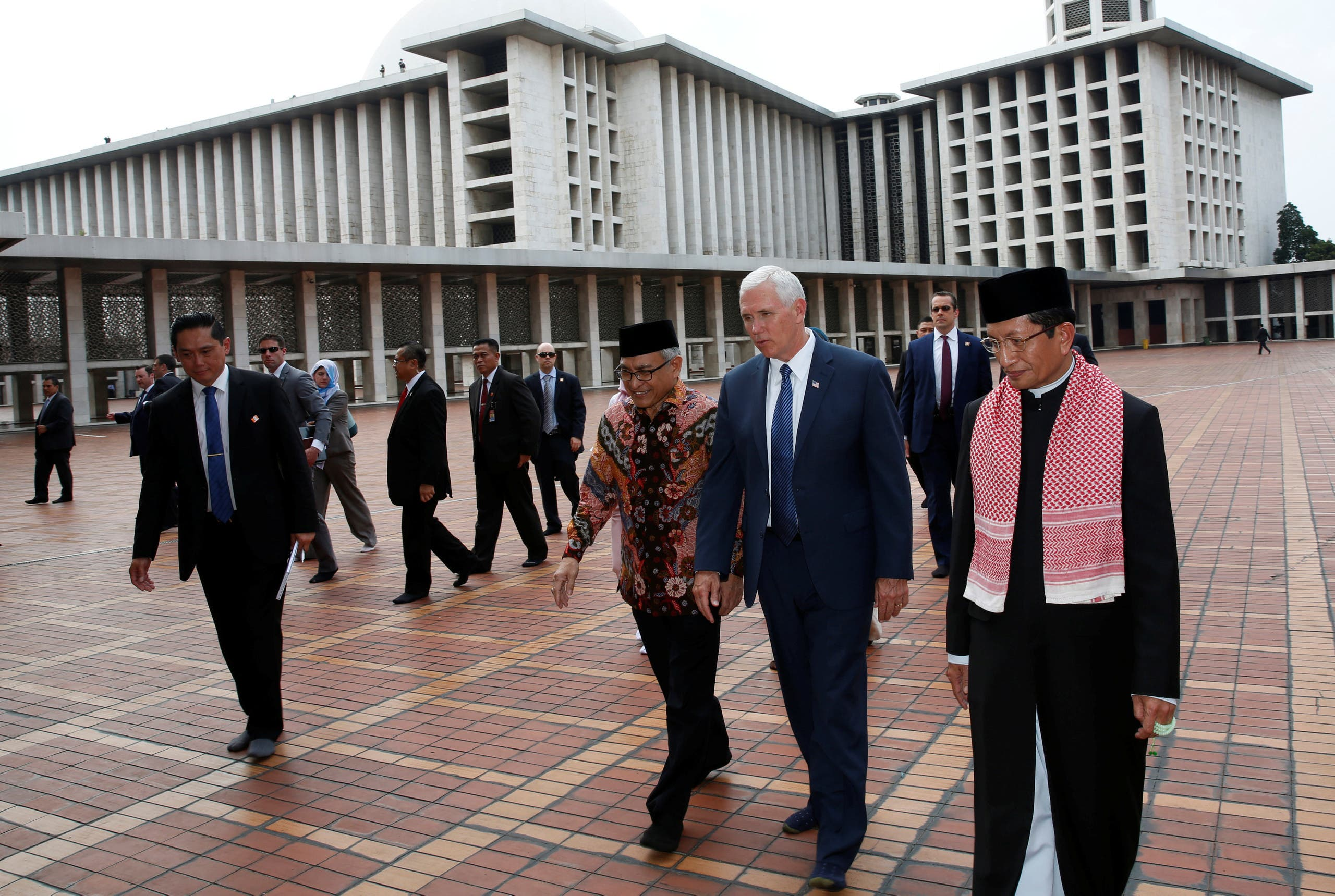 Chief Imam Nasaruddin Umar (left) and Chairman of the Istiqlal Mosque Management Executive Board, Muhammad Muzammil Basyuni (right) during his visit to the Istiqlal Mosque in Jakarta. (Reuters)