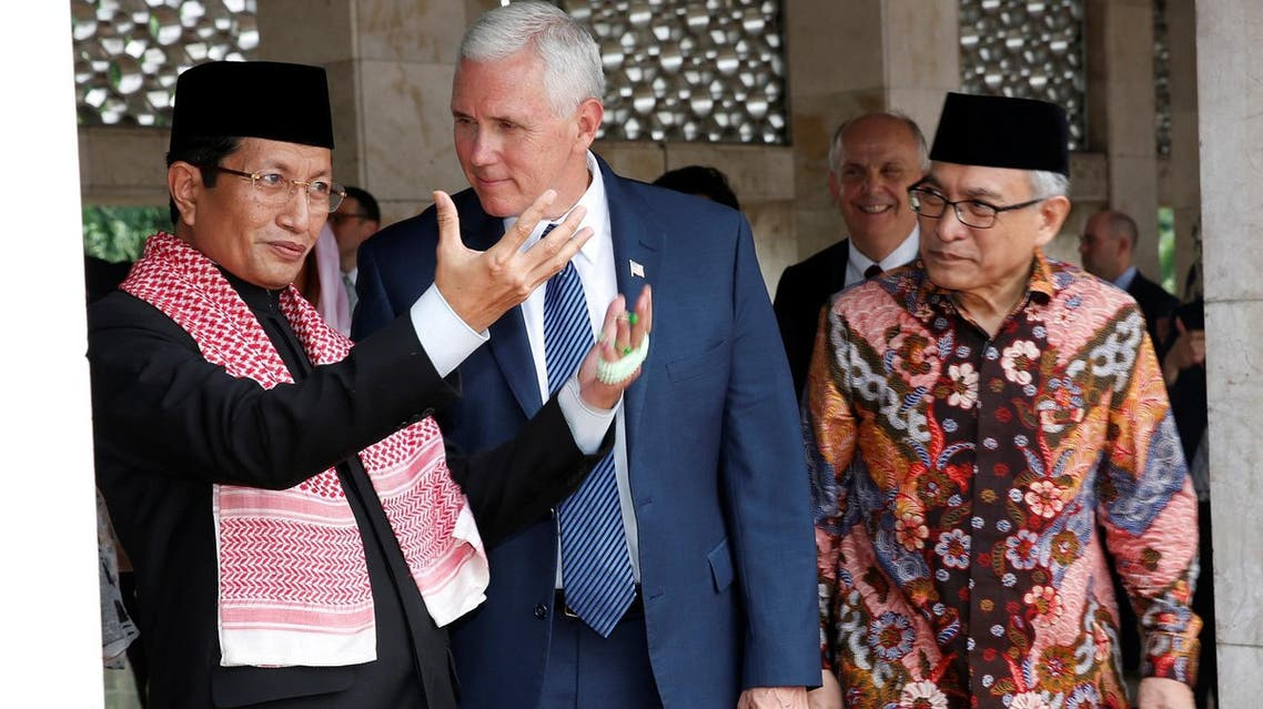 US Vice President Mike Pence accompanied by Chief Imam Nasaruddin Umar (left) and Chairman of the Istiqlal Mosque Management Executive Board, Muhammad Muzammil Basyuni (right) during his visit to the Istiqlal Mosque in Jakarta, on April 20, 2017. (Reuters)