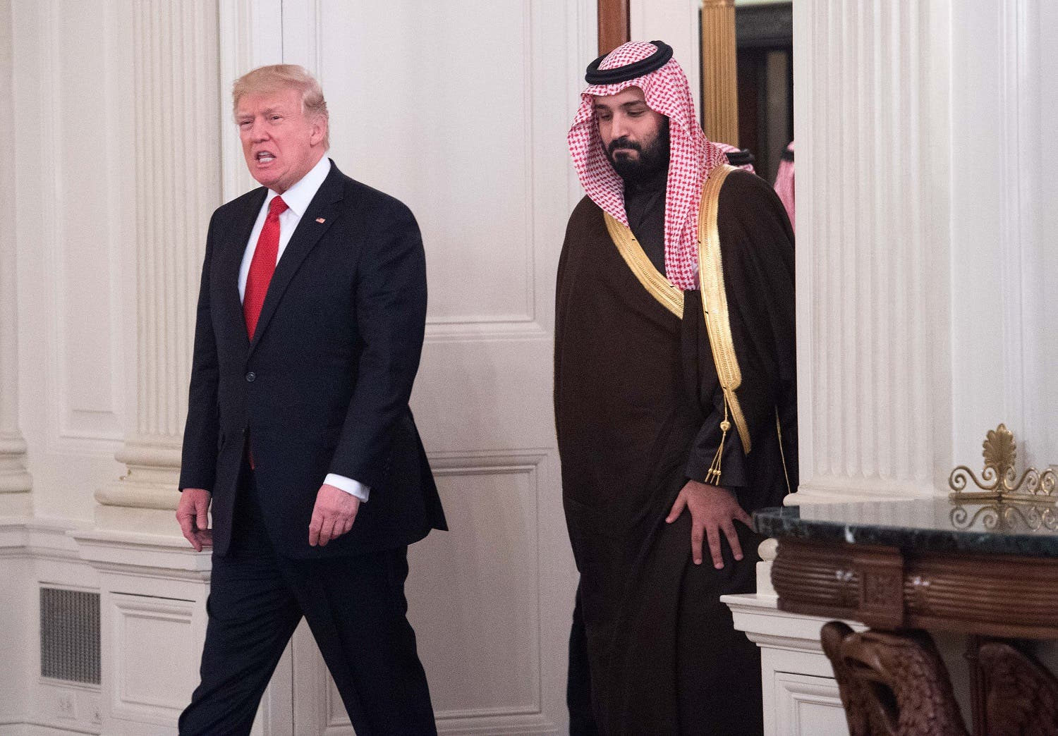 Donald Trump and Saudi Deputy Crown Prince Mohammed bin Salman enter the State Dining Room before lunch at the White House in Washington, DC, on March 14, 2017. (File photo: AFP)