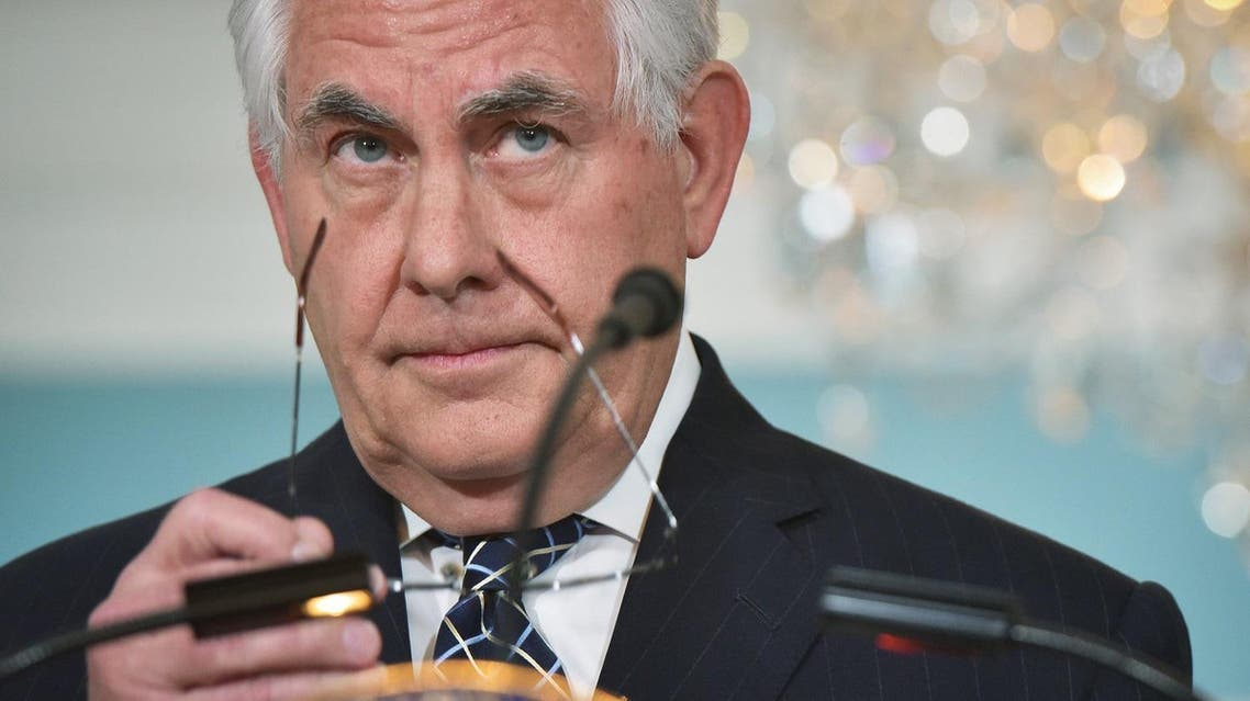 """US Secretary of State Rex Tillerson takes off his glasses after delivering a statement on Iran in the Treaty Room of the State Department in Washington, DC, on April 19, 2017. US President Donald Trump's administration has launched a review of the Iran nuclear deal, officials said April 18, branding it a """"failed approach"""" to the threat posed by the Tehran regime. (AFP)"""