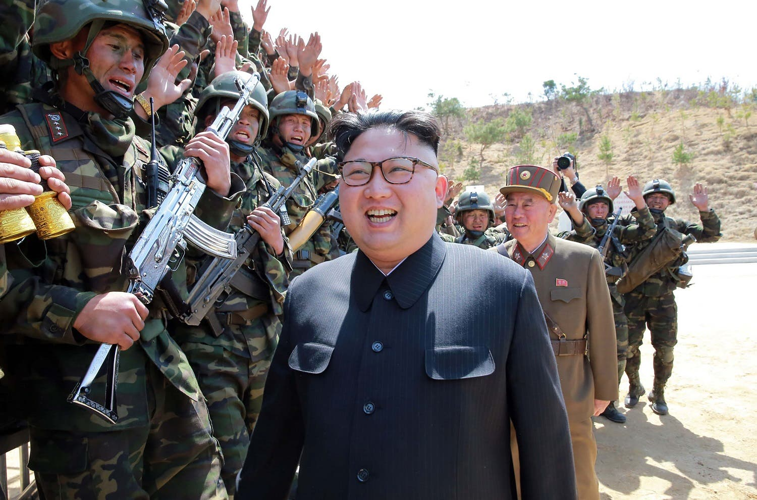 """Kim Jong-Un inspecting the """"Dropping and Target-striking Contest of KPA Special Operation Forces – 2017"""" at an undisclosed location in North Korea on April 14, 2017. (AFP)"""
