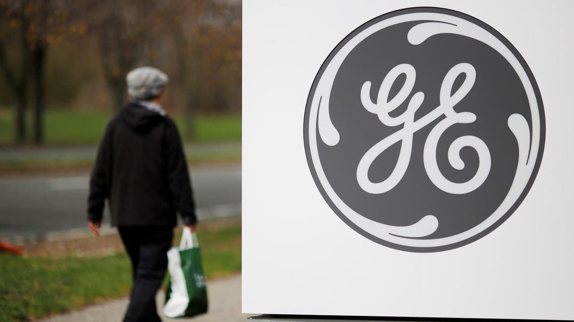 A pedestrian walks past a General Electric (GE) facility in Medford, Massachusetts, US, on April 20, 2017. (Reuters)