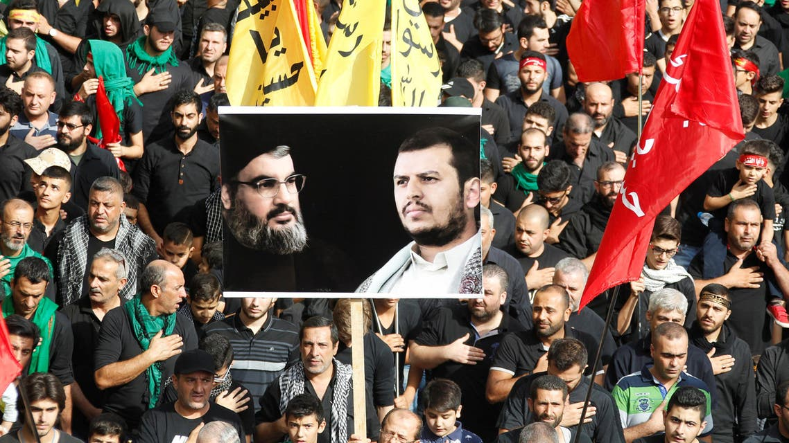Lebanese Hezbollah supporters carry flags and a picture of Lebanon's Hezbollah leader Sayyed Hassan Nasrallah and leader of Yemen's Houthi movement Abdel Malek al-Houthi at a religious procession to mark Ashura in Beirut's southern suburbs, Lebanon October 12, 2016. (Reuters)