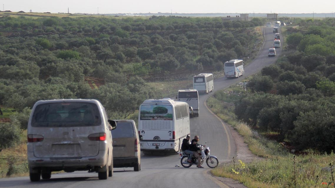A convoy of buses and ambulances transporting wounded civilians and rebels from the Syrian villages of Zabadani and Madaya heads towards the northern town of Idilib on April 21, 2016. (AFP)