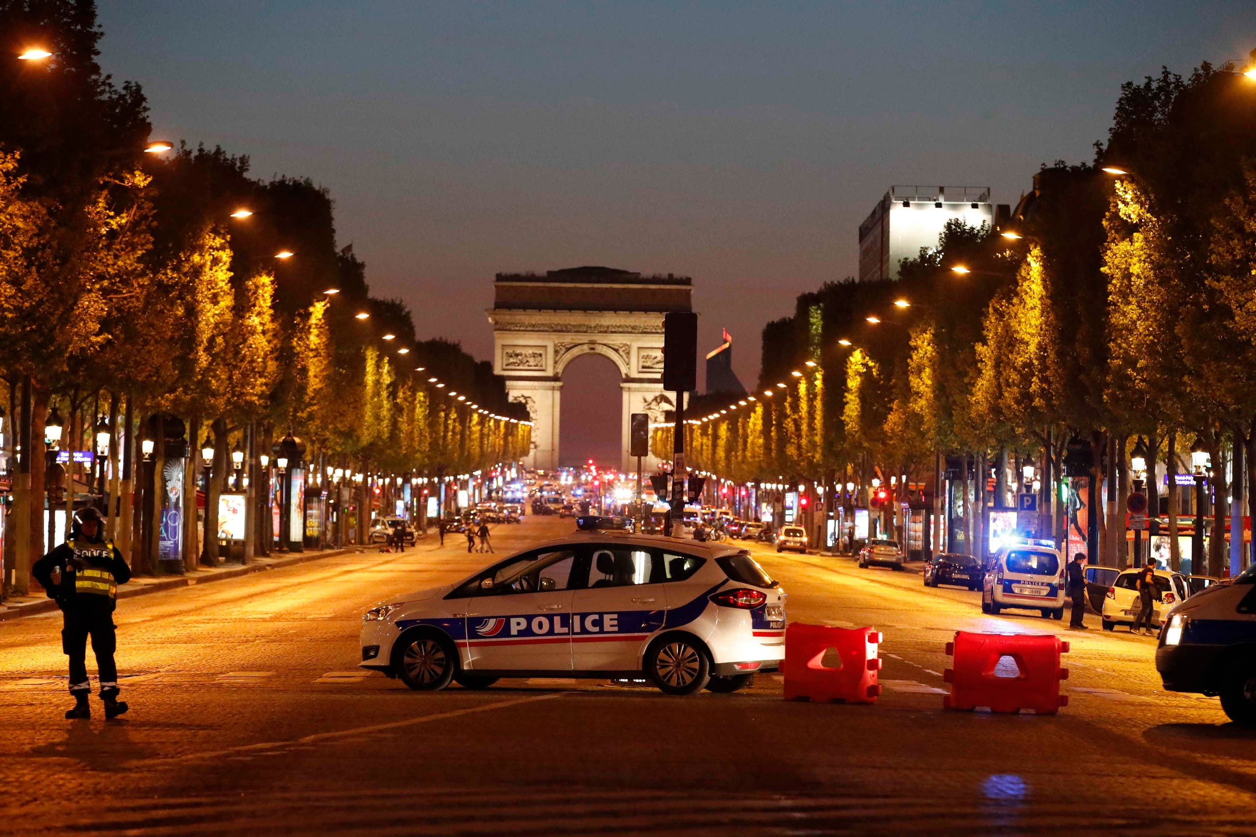 Police secure the Champs Elysee Avenue after one policeman was killed and another wounded in a shooting incident in Paris, France, April 20, 2017. (Reuters