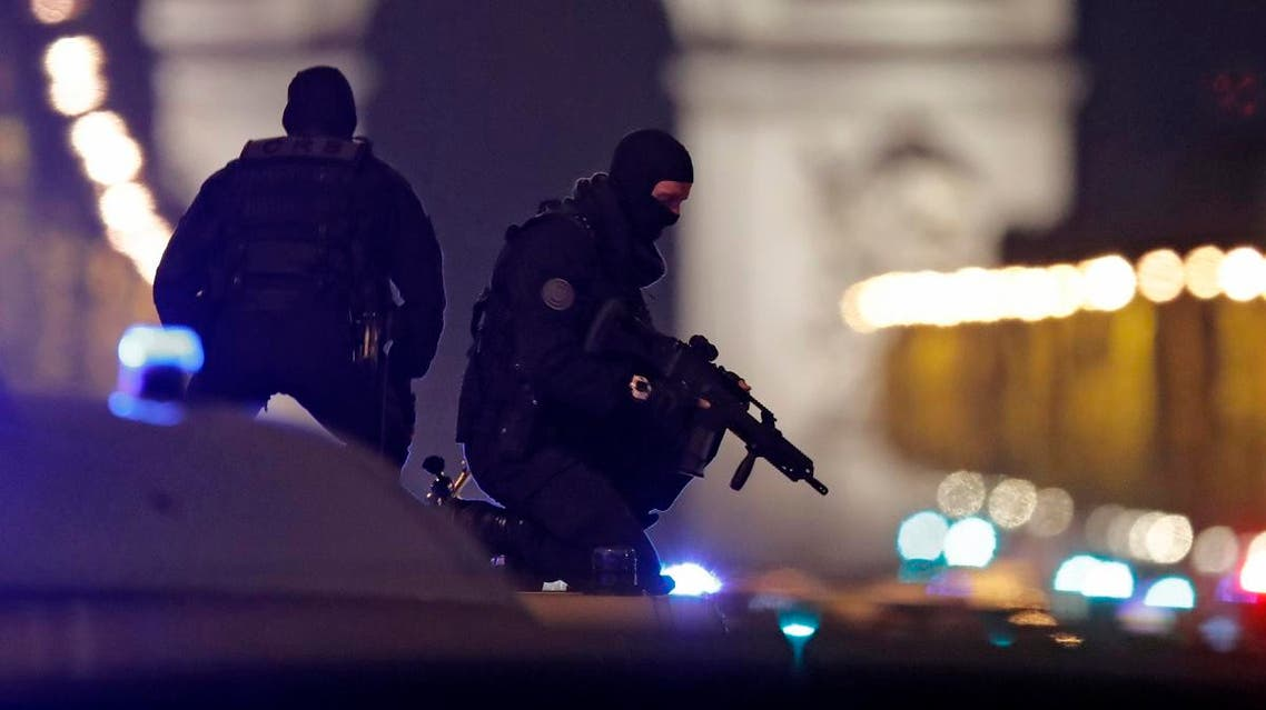 Masked police stand on top of their vehicle on the Champs Elysees Avenue after a policeman was killed in a shooting incident in Paris. (Reuters)
