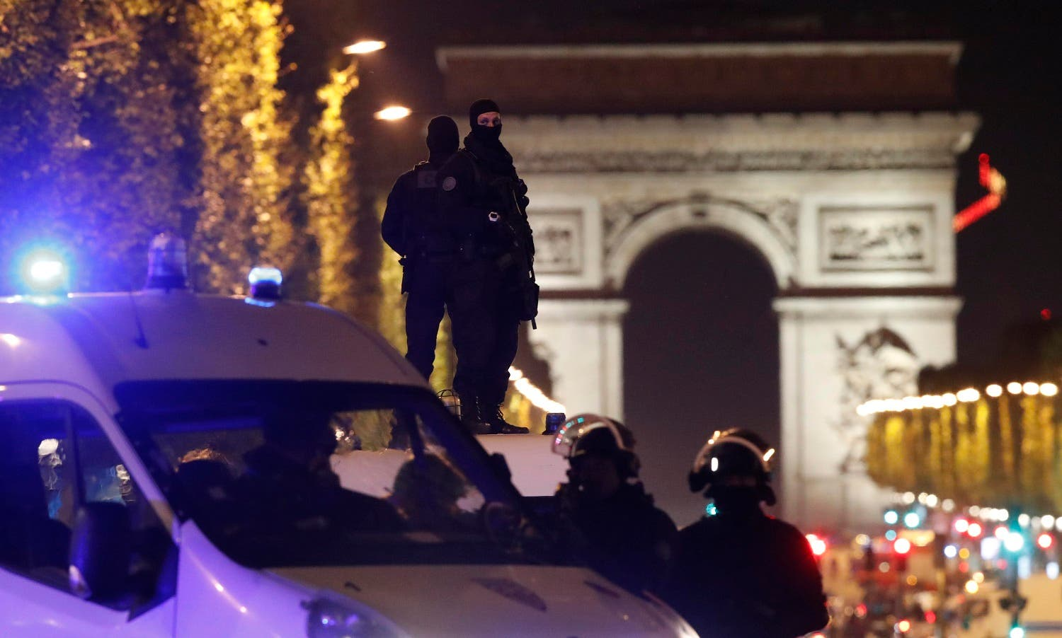 Masked police stand on top of their vehicle on the Champs Elysees Avenue after the shooting incident in Paris, on April 20, 2017. (Reuters)