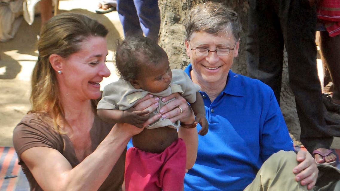 File photo of Microsoft Corp. founder and philanthropist Bill Gates, right, and his wife Melinda Gates attend to a child as they meet with members of the Mushar community at Jamsot Village near Patna, India. (AP)