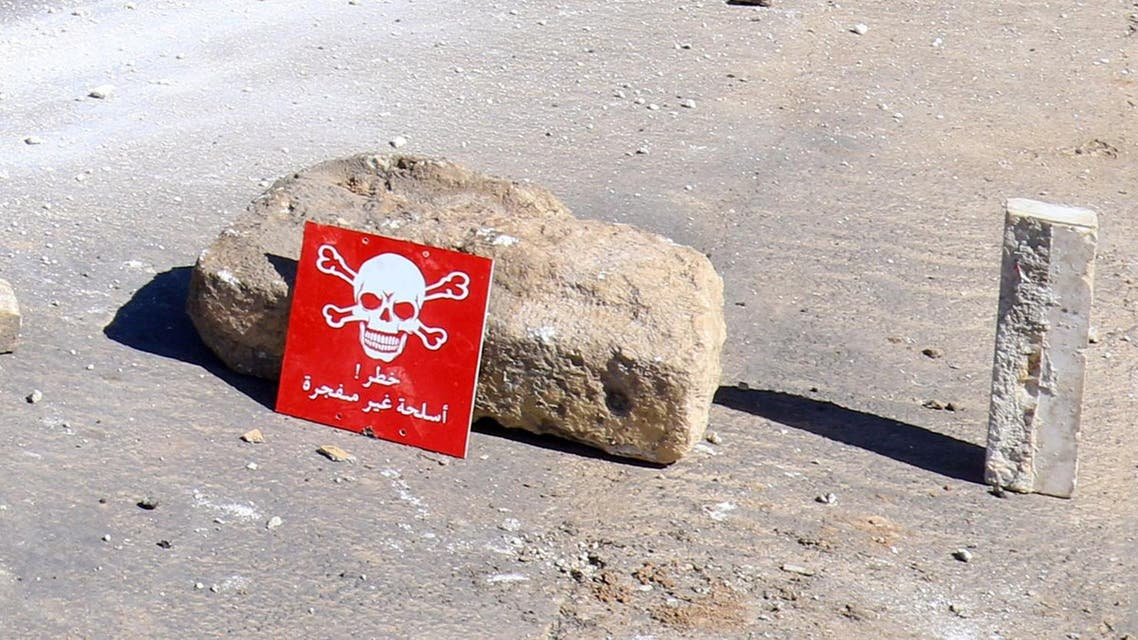 """A hazard sign at a site hit by an airstrike on Tuesday in the town of Khan Sheikhoun in rebel-held Idlib, Syria April 5, 2017. The hazard sign reads, """"Danger, unexploded ammunition"""". (Reuters)"""