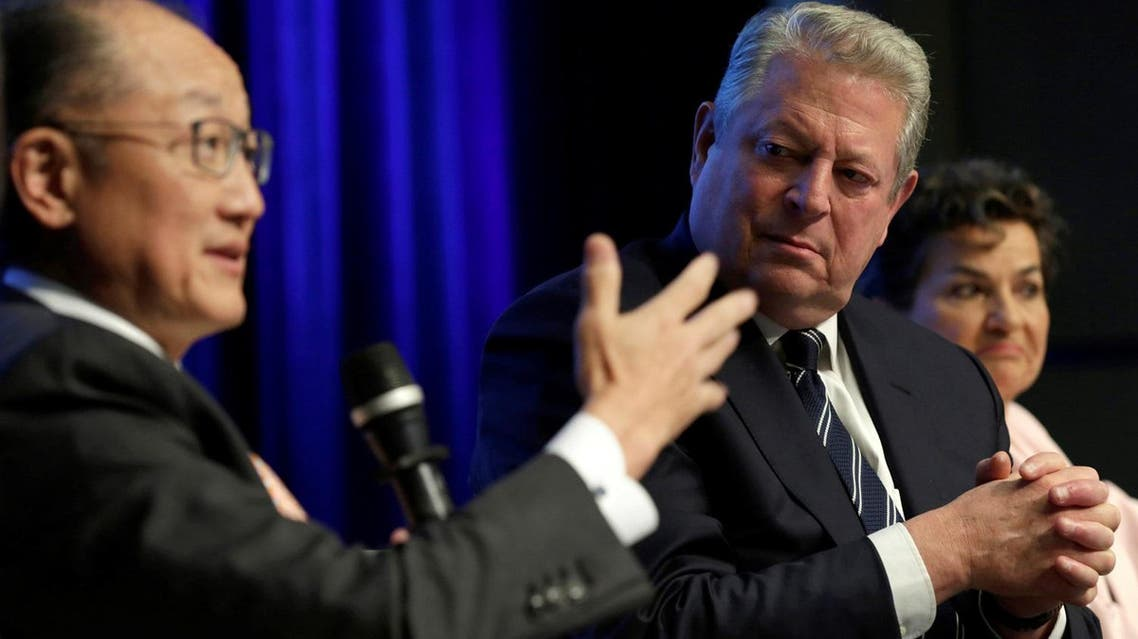 Former US Vice President Al Gore (right) listens to World Bank President Jim Yong Kim at Unlocking Financing for Climate Action session  in Washington on April 21, 2017. (Reuters)