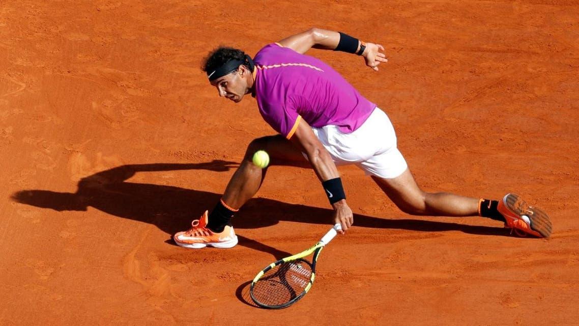 Rafael Nadal of Spain plays a shot to David Goffin of Belgium. (Reuters)