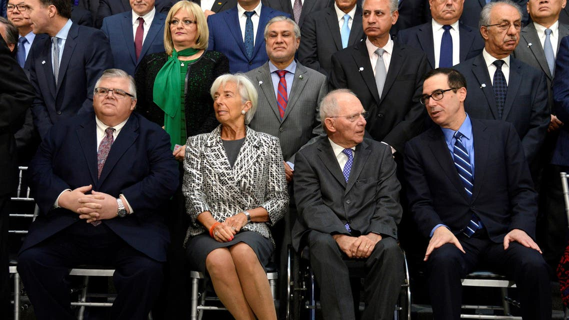 Mexico's Finance Minister Agustin Carstens, IMF Managing Director Christine Lagarde, Germany's Finance Minister Wolfgang Schauble and US Treasury Secretary Steven Mnuchin take their seats for a group photo  on April 22, 2017. (Reuters)