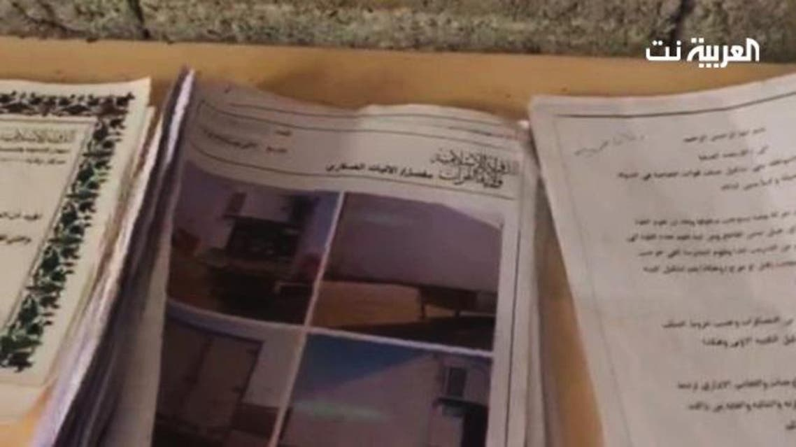 Documents and photos belonging to ISIS found by Iraqi forces. (Supplied)
