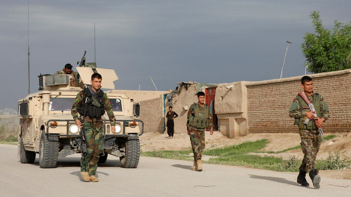 Afghan national Army (ANA) troops arrive near the site of an ongoing attack on an army headquarters in Mazar-i-Sharif northern Afghanistan April 21, 2017.