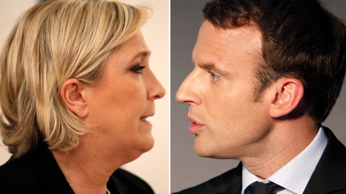 A combination picture shows portraits of the candidates who will run in the second round in the 2017 French presidential election, Emmanuel Macron (L), head of the political movement En Marche !, or Onwards !, and Marine Le Pen, French National Front (FN) political party leader. Pictures taken March 11, 2017 (R) and February 21, 2017 (L).
