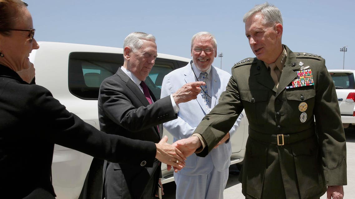US Defense Secretary James Mattis, (second left) and other members of their delegation as they arrive at Camp Lemonnier in Ambouli, Djibouti, on April 23, 2017. (AP)