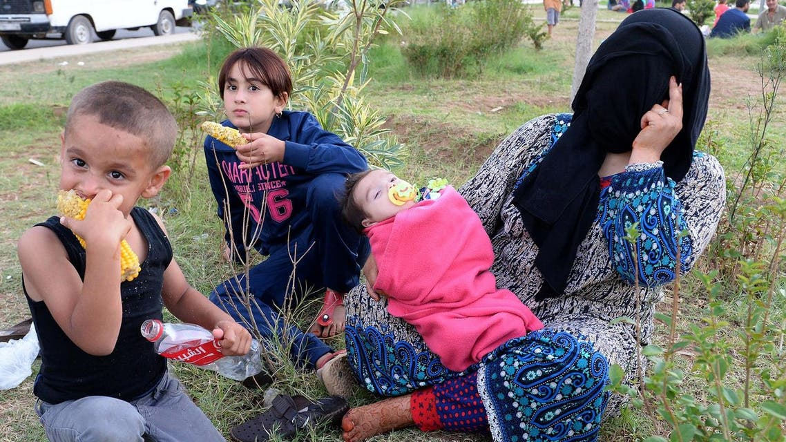 A Syrian mother and her children sit on September 17, 2015 at a park where around 1000 Syrians migrants are gathering in the Moroccan town of Nador. (File photo: AFP)